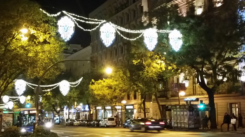 Chandelier lighting decors send warmth and illumination throughout wintry Calle de Goya, in Salamanca