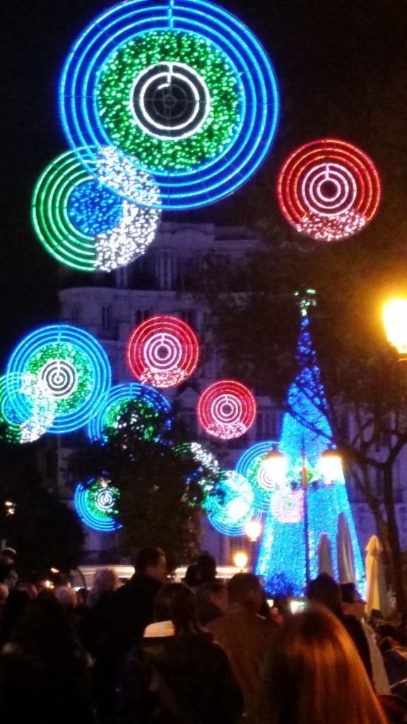 Christmas Lights shaped in circle mesmerize passers-by at Calle de la Montera