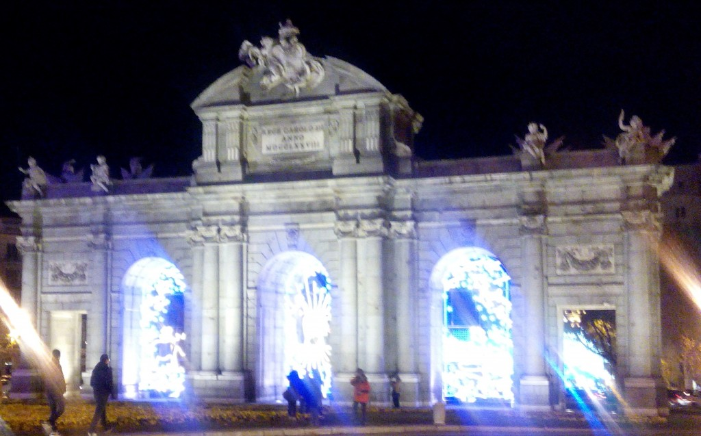 Puerta de Alcala stands in the middle of Plaza de la Independencia. Madrid, Spain